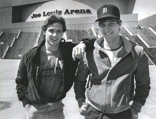 Former Detroit Red Wings teammates Steve Yzerman and Lane Lambert stand in front of the Joe Louis Arena in 1984.