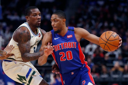 Detroit Pistons guard Brandon Knight drives as Milwaukee Bucks guard Eric Bledsoe defends during the second half Thursday, Feb. 20, 2020, in Detroit.