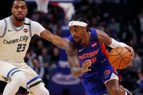 Detroit Pistons guard Jordan Bone drives on Milwaukee Bucks guard Sterling Brown during the second half Thursday, Feb. 20, 2020, in Detroit.