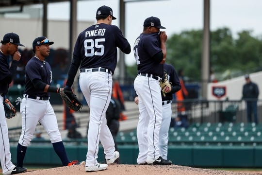 Tigers player talk with pitcher Gerson Moreno during the 6th inning against Southeastern University at Joker Marchant Stadium in Lakeland, Fla., Friday, Feb. 21, 2020.