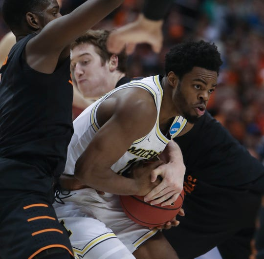 Michigan's Derrick Walton Jr. drives against Oklahoma State during the first round of the NCAA tournament on Friday, March 17, 2017 in Indianapolis.