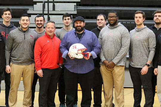 Detroit Lions coach Matt Patricia poses with Rensselaer Polytechnic Institute football players and coaches on Friday, Feb. 14, 2020, in Troy, New York.