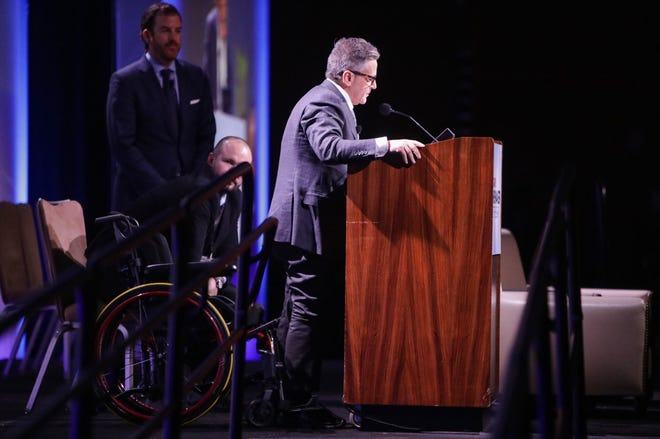 Dan Gilbert is seen on stage during the Crain's Newsmakers of the Year event at MGM Grand on Friday, February 21, 2020.