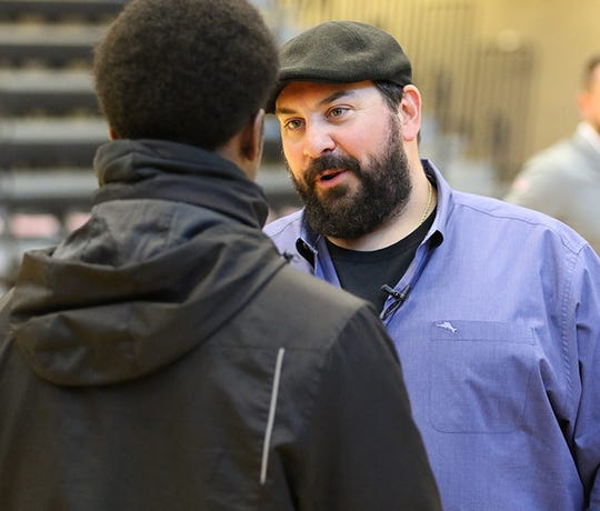 Detroit Lions coach Matt Patricia talks with a Rensselaer Polytechnic Institute football player on Friday, Feb. 14, 2020, in Troy, New York.