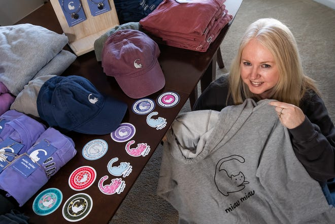 Dina Song of Plymouth poses with some of the clothing items she makes for her business Miau Miau Clothing Co. at her home in Plymouth on Thursday, Feb. 20, 2020.