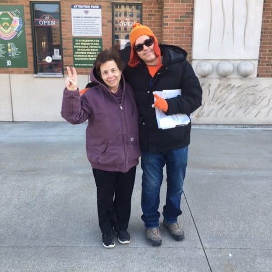 Cindy Drabek and her son, Darrell, pose after buying Tigers tickets on Friday, Feb. 21, 2020, at Comerica Park.