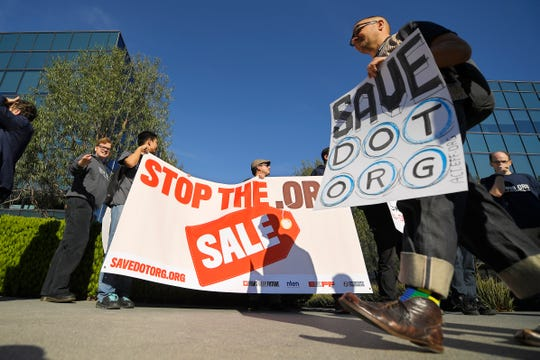 Cory Doctorow, right, walks in front of other protesters in Los Angeles outside the headquarters of the regulatory body for domain names, the Internet Corporation for Assigned Names and Numbers on Jan. 24, 2020.