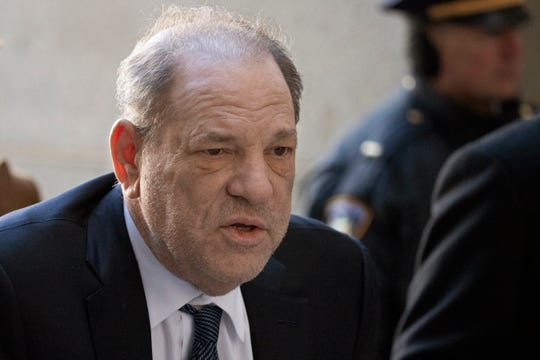 Harvey Weinstein arrives at a Manhattan court as jury deliberations continue in his rape trial, Friday in New York.