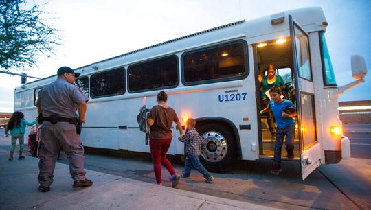 In this May 28, 2014, file photo, migrants are released from ICE custody at a Greyhound bus station in Phoenix. Greyhound, the nation's largest bus company, says it will stop allowing Border Patrol agents without a warrant to board its buses to conduct routine immigration checks. The company announced the change Friday, Feb. 21, 2020, one week after The Associated Press reported on a leaked Border Patrol memo confirming that agents can't board private buses without the consent of the bus company.