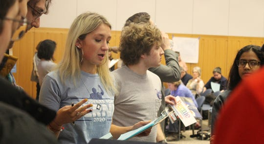 Elizabeth Cetnar, a sophomore at the University of Michigan from Macomb Township, helps organize college students to support Sen. Bernie Sanders' presidential campaign on Tuesday, Feb. 18, 2020.