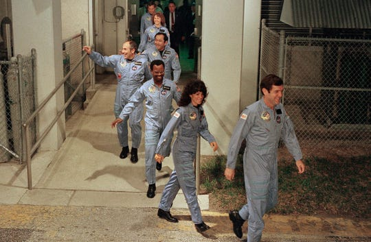 In this Jan. 27, 1986, photo, the crew for the Space Shuttle Challenger flight 51-L leaves their quarters for the launch pad at the Kennedy Space Center in Florida. Mission Spl. Ronald McNair, center, was only the second African American chosen to go to space. He died in the Challenger launch.
