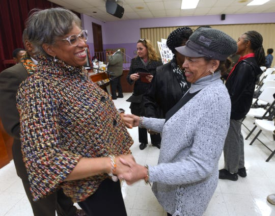 U.S. Congresswoman Brenda Lawrence, left, shares a moment with area resident Marlena Tunstall, 82, after the announcement
