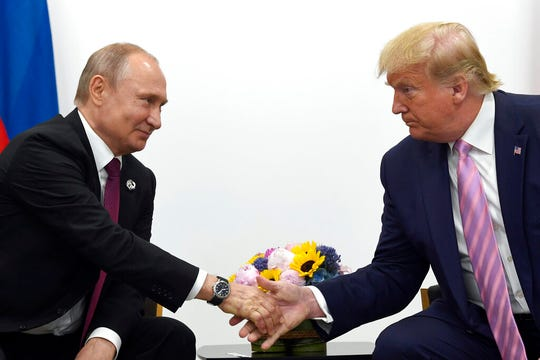 President Donald Trump shakes hands with Russian President Vladimir Putin during a bilateral meeting on the sidelines of the G-20 summit in Osaka, Japan on June 28, 2019.