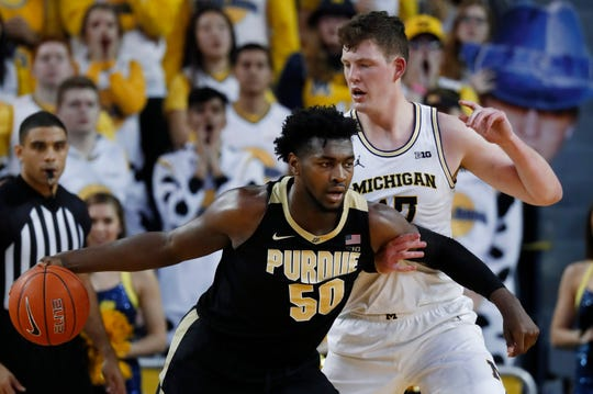 Trevion Williams drives on Jon Teske during the first Purdue vs. Michigan game in Ann Arbor on Jan. 9.