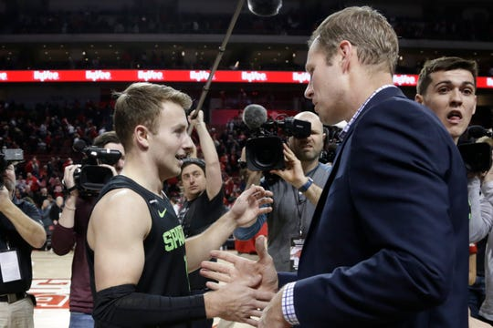 Nebraska coach Fred Hoiberg prepares to embrace his son, Michigan State's Jack Hoiberg (10), following the game.