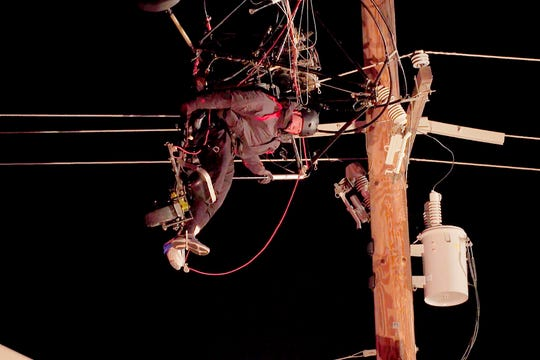 In this image taken from video provided by ABC10/KXTV, a paraglider is trapped in power lines before being rescued in Olivehurst, Calif., Wednesday evening, Feb. 19, 2020.