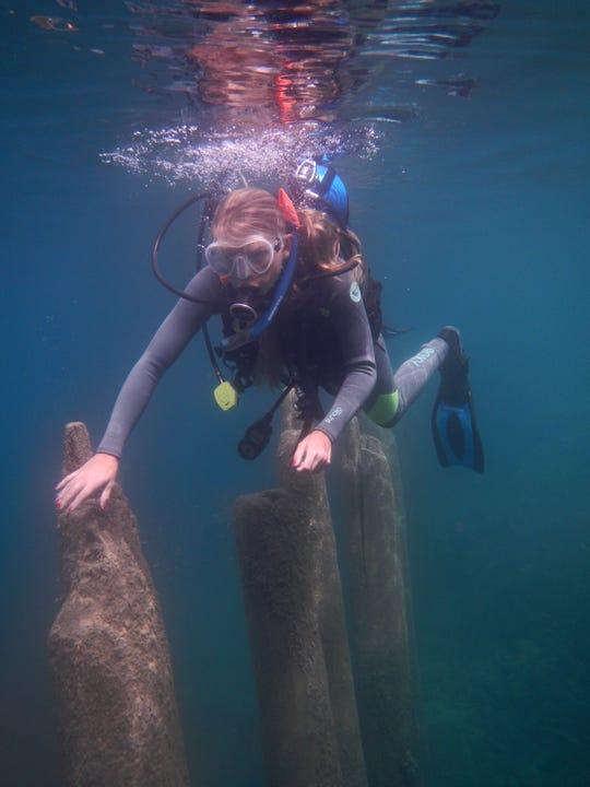 Recreational diver Sarah Campbell explores historic Rockport Harbor.