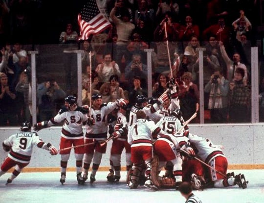 The U.S. hockey team pounces on goalie Jim Craig after a 4-3 victory against the Soviet Union in the semifinals of the 1980 Winter Olympics in Lake Placid, N.Y.