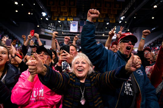 Supporters of President Donald Trump cheer as he arrives to speak to a campaign rally at The Broadmoor World Arena, Thursday, Feb. 20, 2020, in Colorado Springs, Colo.