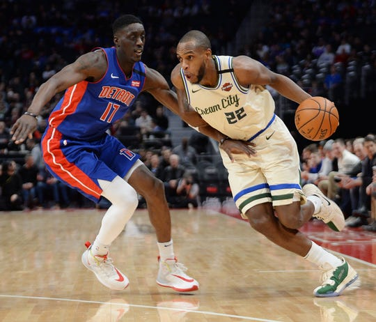 Bucks' Khris Middleton drives around Pistons' Tony Snell in the second quarter.