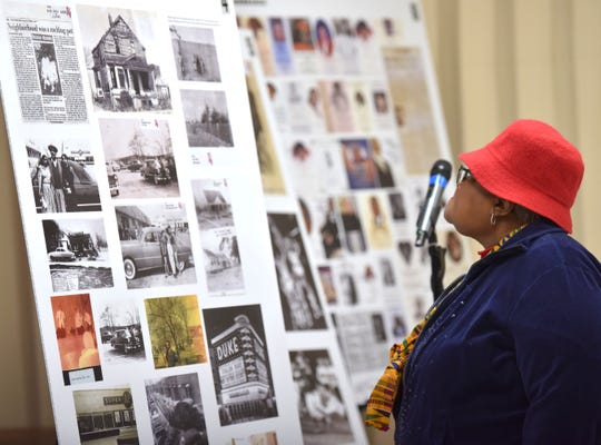 Area resident Virginia Langford looks at images of 8 Mile and Wyoming from the 1950s.