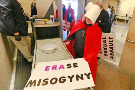 Equal Rights Amendment supporters make their way through security as they arrive for for the 2020 session outside Virginia state Capitol in Richmond, Va., Wednesday, Jan. 8, 2020.