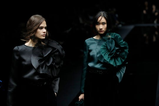 Models wear creations part of Emporio Armani's Fall/Winter 2020/2021 collection, presented in Milan, Italy, Friday, Feb. 21, 2020.