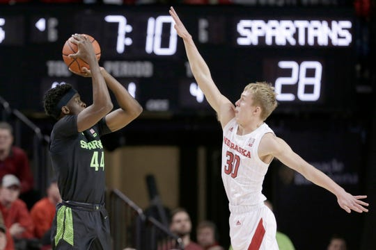 Michigan State's Gabe Brown (44) shoots against Nebraska's Charlie Easley (30) during the first half.