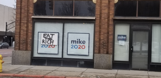 """A sign saying """"Eat the rich"""" was attached to Democratic presidential candidate Mike Bloomberg's Flint office on Feb. 16, according to his campaign."""