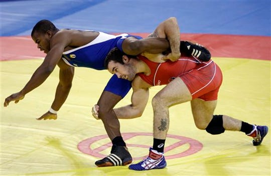 USA's Andy Hrovat, right, wrestles Cuba's Reineris Salas in a 84 kilogram freestyle match at the 2008 Olympics in Beijing, Thursday, Aug. 21, 2008.