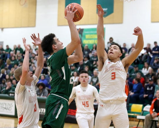 LaRon Boykin of Newfield goes in for a shot as Marathon's Andrew Tillotson (left) and Diego Castellot (3) defend during the Trojans' 57-54 win in the IAC Small School boys basketball championship game Feb. 20, 2020 at Tompkins Cortland Community College.