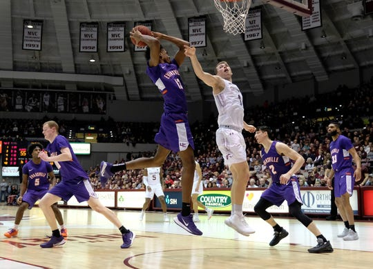 Evansville forward Deandre Williams (13) grabs a rebound from Southern Illinois forward Marcus Domask (1) during the second half at the Banterra Center on Thursday in Carbondale. The Salukis went on to win 70-53.