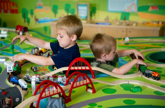 Brothers Benjamin Rausch, 5, left, and Darryl Rausch, 3, of Evansville play with trains during CMOE's 13th birthday celebration, Saturday afternoon, Sept. 28, 2019. A resolution pending before the Evansville City Council endorses which local nonprofits should receive city government funding in 2021, and it calls for several changes. The non-binding resolution written by Jonathan Weaver, D-At-Large, and Missy Mosby, D-Second Ward, states city support for nonprofits next year should include only 11 specific organizations... CMOE which received $7,000 last year is not one of them.
