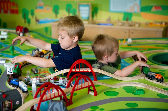 Brothers Benjamin Rausch, 5, left, and Darryl Rausch, 3, of Evansville play with trains during CMOE's 13th birthday celebration, Saturday afternoon, Sept. 28, 2019.