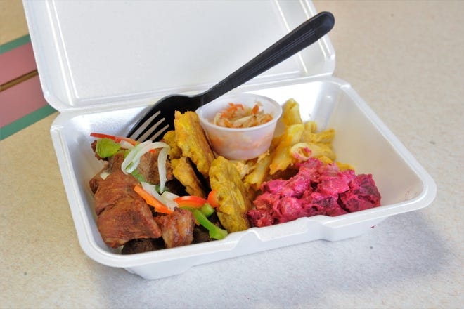 Fried pork, fried plantains, pikliz relish, macaroni and cheese and potato-beet salad at Caribbean Cuisine on Kentucky Avenue.