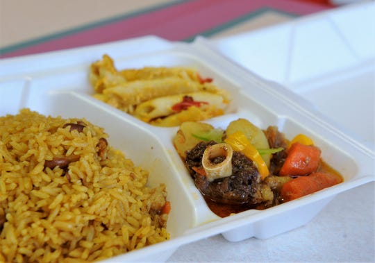 Simmered oxtail with vegetables, rice and beans and macaroni and cheese at Caribbean Cuisine on Kentucky Avenue.