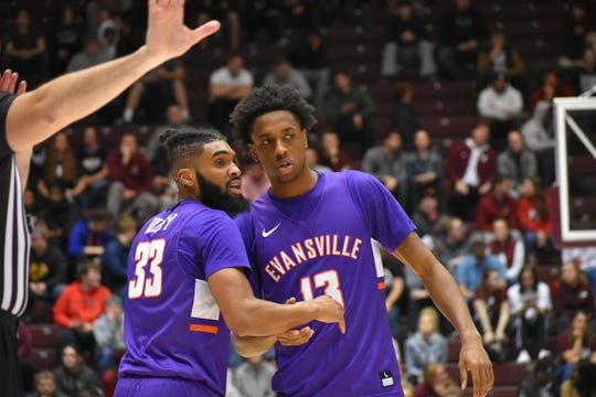 DeAndre Williams and KJ Riley (left) talk during Evansville's game at Southern Illinois on Thursday in Carbondale.
