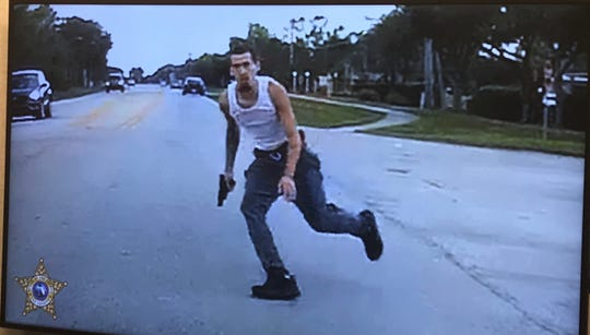 This photo, from a witness' car-mounted video camera, shows Ricky Ruiz running from the scene of a fatal shooting Wednesday evening in Lehigh Acres, authorities said. Ruiz and Victor Colon Jr. were arrested in the Miami area Thursday in connection with the shooting. They will be returned to Lee County to face charges of homicide and shooting into an occupied vehicle, authorities said.