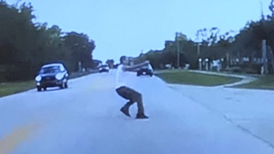 Ricky Ruiz, pictured, and Victor Colon Jr. were arrested in the Miami area and will be returned to Lee County to face charges of homicide and shooting into an occupied vehicle. The two men were alleged to have been involved in a fatal shooting Wednesday evening in Lehigh Acres. This photo, recorded by a witness' car-mounted video camera, shows Ruiz running from the scene, authorities said.