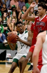 Fort Myers High School Javian McCollum (25) drives to the basket as Palmetto High School's Xavier Washington (14) tries to defend during their Class 6A regional quarterfinal game at Fort Myers High School in Fort Myers,Thursday,Feb.20,2020.(Photo/Chris Tilley)