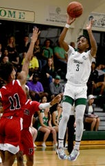 Fort Myers High School Jamin Primus (3) takes a jump shot over  Palmetto High School Zorian Geathers (11) during their Class 6A regional quarterfinal game at Fort Myers High School in Fort Myers,Thursday, Feb.20,2020.(Photo/Chris Tilley)