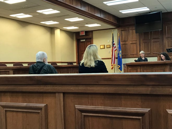 Richard G. Pierce appeared in court for an evidentiary hearing Tuesday with Attorney Kate Zuidmulder. Above, cadaver dog handler Carren Corcoran testifies.