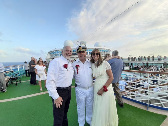 The captain of Mark and Jill Schwarzbauer's Princess Cruise ship officiated the world's largest multi-location vow renewal ceremony the couple participated in.