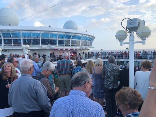 More than 1,400 couples gathered for a joint vow renewal ceremony on board a Princess Cruise ship to break the Guinness world record for largest multi-location vow renewal.