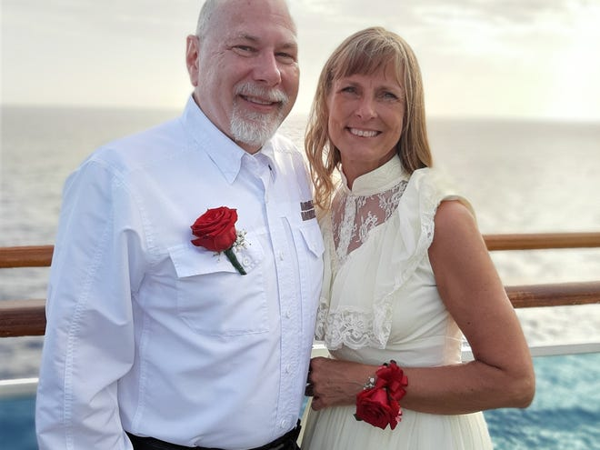 Mark and Jill Schwarzbauer on board a Princess Cruise ship, where they joined more than 1,400 other couples for a record-breaking wedding vow renewal ceremony on Feb. 11, 2020.