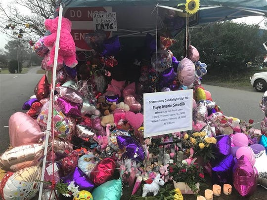 Flowers and balloons piled up at the entrance of Faye Swetlik's neighborhood, Feb. 18, 2020. Faye was a first-grader at Springdale Elementary School, a part of Lexington School District 2.