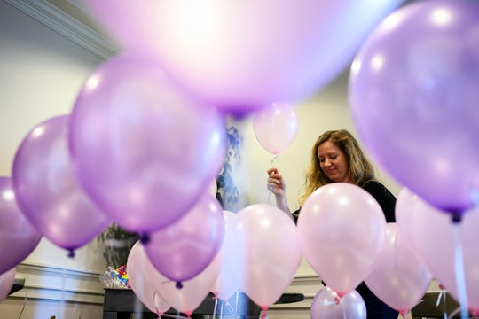 Morgan Proctor helps blow up balloons before the remembrance service for six-year-old Faye Swetlik at Trinity Baptist Church Cayce Friday, Feb. 21, 2020.