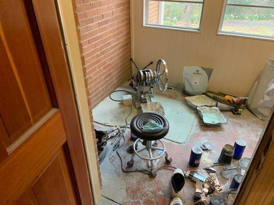 An illegal pill press seized during a bust Thursday sits in a Greenville County residence.