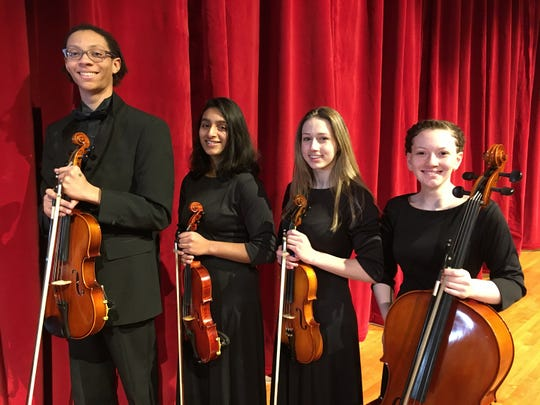 "C. M. Russell High School students (from left) Adonai Gray, Gail Parambi, Sidalee Sneed and Jayla Mitchell will perform in ""Beatles vs. Stones - A Musical Showdown"" at the Masnfield Center for the Performing Arts on Saturday, Fed. 29th at 7:30 p.m."