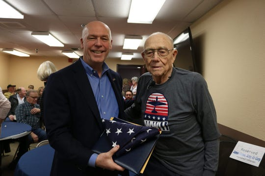 Montana Congressman Greg Gianforte (left) presents James Geiger of Conrad an American flag flown over the U.S. Capitol in honer of Geiger's of Geiger's selection as a recipient of the Montana Congressional Veteran Commendation.